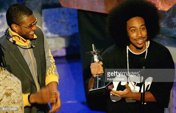 Musicians Usher and Ludacris accept the Viewer's Choice Award on stage at the 2004 Black Entertainment Awards held at the Kodak Theatre on June 29...