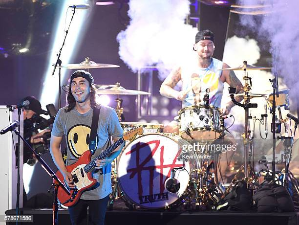 Musicians Vic Fuentes and Mike Fuentes of the band Pierce the Veil performs onstage at the MTV Fandom Awards San Diego at PETCO Park on July 21 2016...
