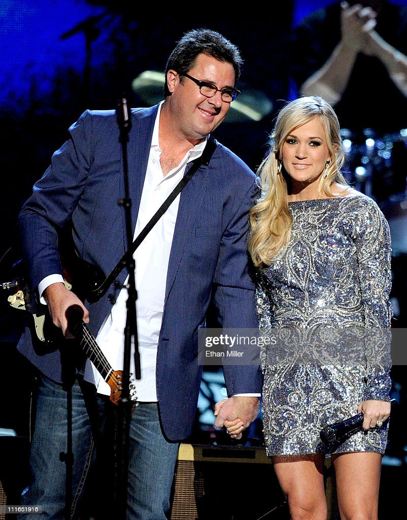 Musicians <a gi-track='captionPersonalityLinkClicked' href=/galleries/search?phrase=Vince+Gill&family=editorial&specificpeople=215309 ng-click='$event.stopPropagation()'>Vince Gill</a> and <a gi-track='captionPersonalityLinkClicked' href=/galleries/search?phrase=Carrie+Underwood&family=editorial&specificpeople=204483 ng-click='$event.stopPropagation()'>Carrie Underwood</a> perform onstage during ACM Presents: Girls' Night Out: Superstar Women of Country concert held at the MGM Grand Garden Arena on April 4, 2011 in Las Vegas, Nevada.
