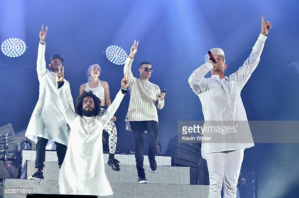 Musicians Walshy Fire of Major Lazer Jillionaire of Major Lazer special guest MØ special guest DJ Snake and record producer Diplo of Major Lazer...