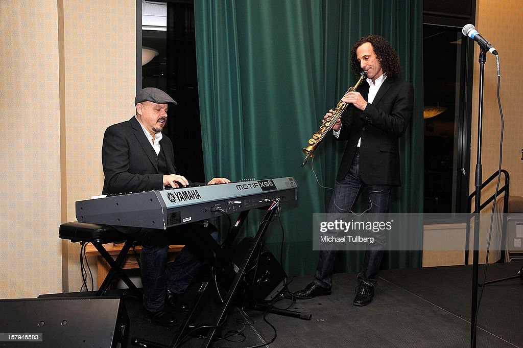 Musicians Walter Afanasieff and <a gi-track='captionPersonalityLinkClicked' href=/galleries/search?phrase=Kenny+G&family=editorial&specificpeople=211357 ng-click='$event.stopPropagation()'>Kenny G</a> perform at the new Christmas children's book 'ELFBOT' at The Americana at Brand on December 7, 2012 in Glendale, California.