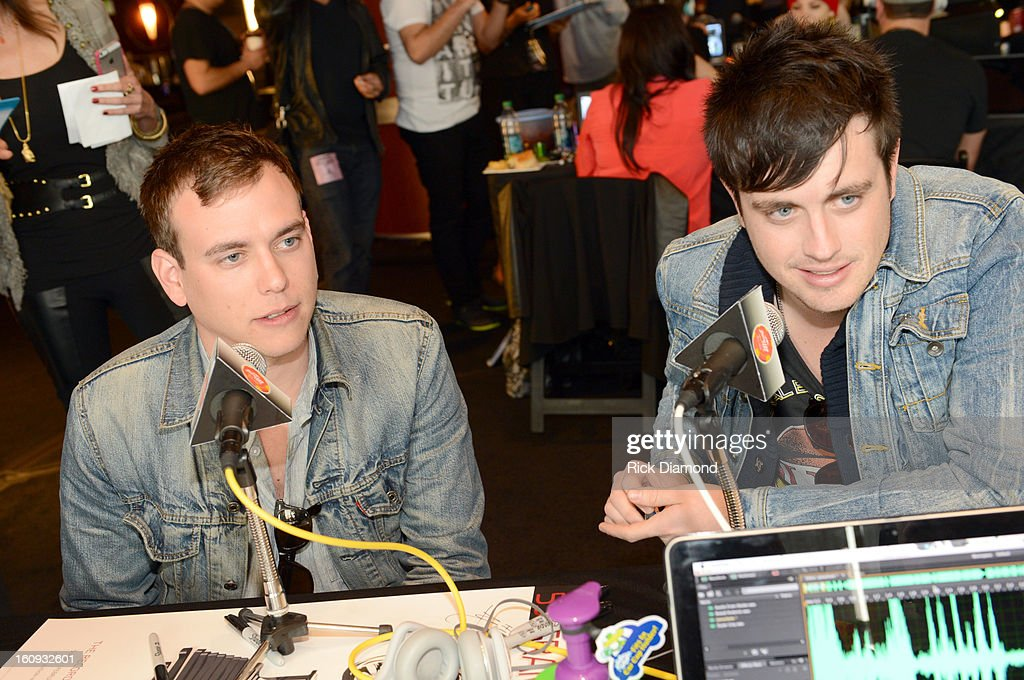 Musicians Will Anderson (L) and Johnny Stubblefield of the band Parachute are interviewed backstage at the GRAMMYs Dial Global Radio Remotes during The 55th Annual GRAMMY Awards at the STAPLES Center on February 7, 2013 in Los Angeles, California.