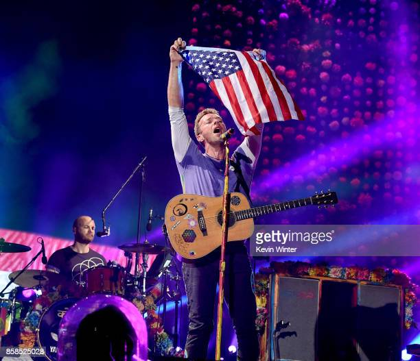 Musicians Will Champion and Chris Martin of Coldplay perform at the Rose Bowl on October 6 2017 in Pasadena California