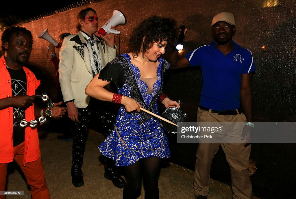 Musicians Win Butler and Regine Chassagne of Arcade Fire perform with members of Preservation Hall Jazz band in the crowd during day 3 of the 2014 Coachella Valley Music & Arts Festival at the Empire Polo Club on April 20, 2014 in Indio, California.