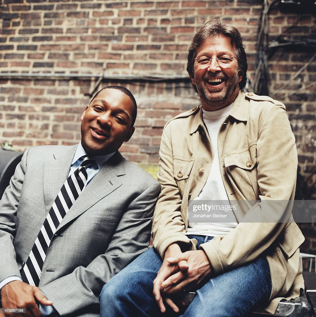 Musicians <a gi-track='captionPersonalityLinkClicked' href=/galleries/search?phrase=Wynton+Marsalis&family=editorial&specificpeople=215421 ng-click='$event.stopPropagation()'>Wynton Marsalis</a> and <a gi-track='captionPersonalityLinkClicked' href=/galleries/search?phrase=Eric+Clapton&family=editorial&specificpeople=158744 ng-click='$event.stopPropagation()'>Eric Clapton</a> are photographed for Vanity Fair Magazine on June 2, 2003 in the back alley of the Apollo Theater in Harlem, New York.