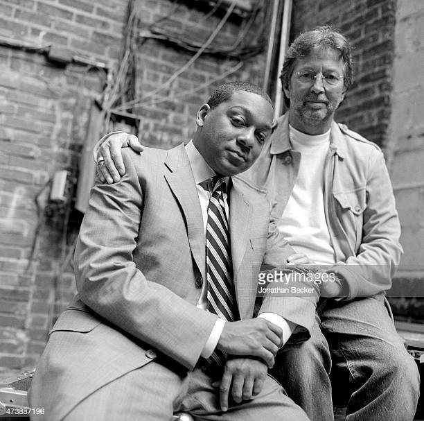 Musicians Wynton Marsalis and Eric Clapton are photographed for Vanity Fair Magazine on June 2 2003 in the back alley of the Apollo Theater in Harlem...