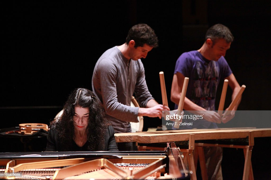 Musicians Xan Errotabehere (L) and Thierry Biscary of the Kalakan Trio practices their percussion instruments during rehearsal with French sisters, concert pianists Katia Labeque and Marielle Labeque (L) for Ravel's 'Bolero' arrangement for duo piano as part of 'Imagine' family concerts and also the 'The Rest Is Noise' programming at the Queen Elizabeth Hall on February 17, 2013 in London, England.
