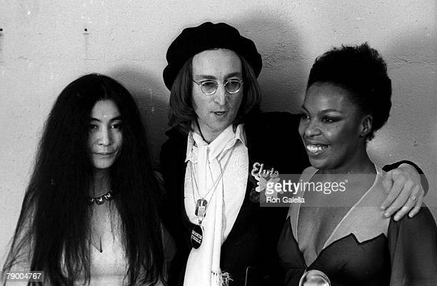 Musicians Yoko Ono John Lennon and Roberta Flack attending 17th Annual Grammy Awards on March 1 1975 at the Uris Theater in New York City New York