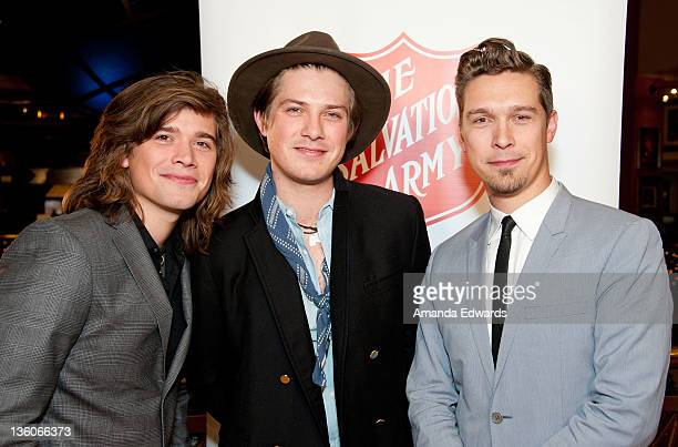 Musicians Zac Hanson Taylor Hanson and Isaac Hanson of Hanson arrive at The Salvation Army's Red Kettles 2nd Annual 'Rock The Red Kettle' Holiday...