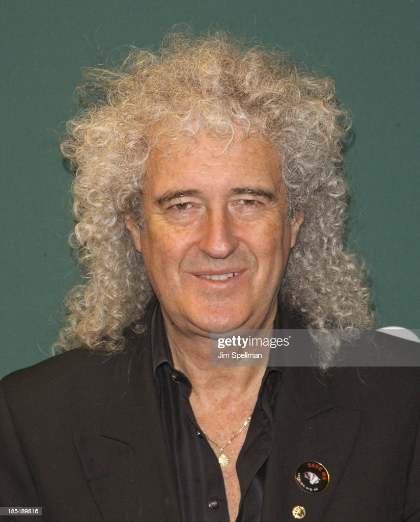 Musician/singer/ songwriter <a gi-track='captionPersonalityLinkClicked' href=/galleries/search?phrase=Brian+May&family=editorial&specificpeople=158059 ng-click='$event.stopPropagation()'>Brian May</a> signs copies of his book 'Diableries: Stereoscopic Adventures In Hell' at Barnes & Noble, 5th Avenue on October 21, 2013 in New York City.