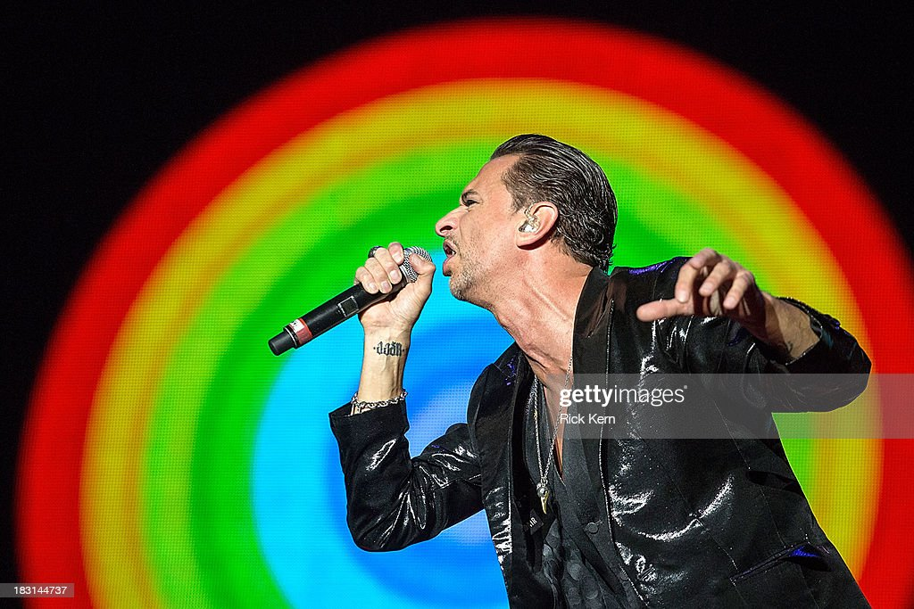 Musician/vocalist <a gi-track='captionPersonalityLinkClicked' href=/galleries/search?phrase=Dave+Gahan&family=editorial&specificpeople=537515 ng-click='$event.stopPropagation()'>Dave Gahan</a> of Depeche Mode performs on stage during weekend one, day one of the Austin City Limits Music Festival at Zilker Park on October 4, 2013 in Austin, Texas.