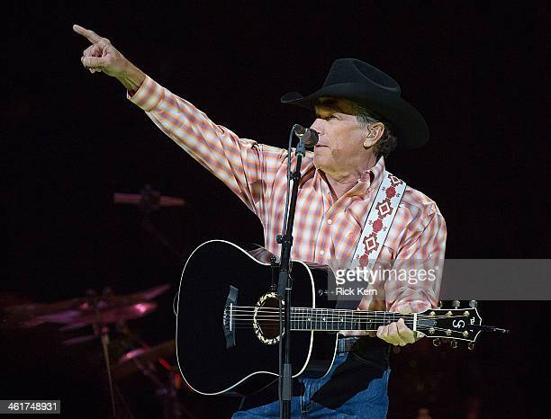 Musician/vocalist George Strait performs in concert during 'George Strait The Cowboy Rides Away Tour' at the Frank Erwin Center on January 10 2014 in...