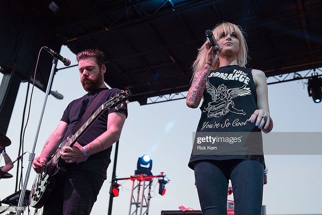 Musician/vocalist Gregori Chad Petree (L) and Carah Faye Charnow of Shiny Toy Guns perform in concert during the Keep Austin Weird Festival at The Long Center on June 22, 2013 in Austin, Texas.
