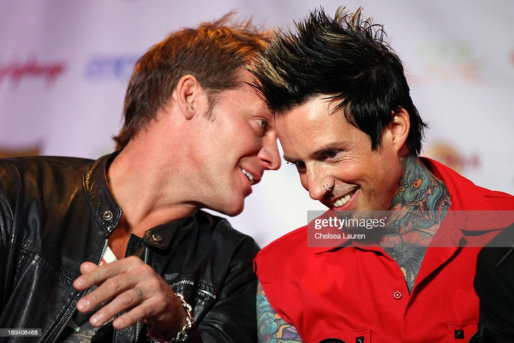 Musician/wrestler Chris Jericho (L) and drummer Jeremy Spencer of Five Finger Death Punch attend the Revolver Golden Gods Awards press conference at Hard Rock Cafe - Hollywood on January 30, 2013 in Hollywood, California.