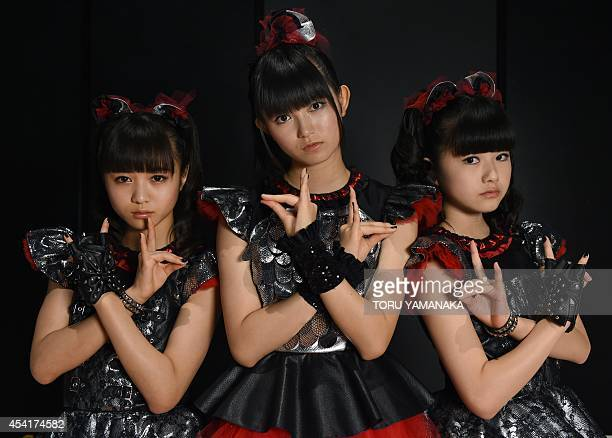 MusicJapanBabyMetallifestyleentertainmentcultureINTERVIEW In this picture taken on August 16 members of Japan's pop group Babymetal Moameta SuMetal...