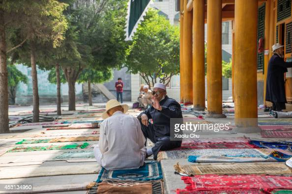 Musilm talk to each other in in Xining Dongguan Mosque on August 1 2014 in Xining China Xining is the main Muslim city in northwest China