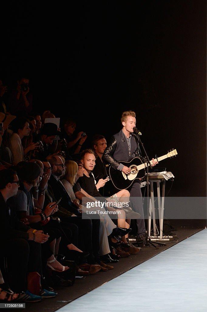 Musisian Mads Langer sings during the Kilian Kerner Show during Mercedes-Benz Fashion Week Spring/Summer 2014 at Brandenburg Gate on July 2, 2013 in Berlin, Germany.