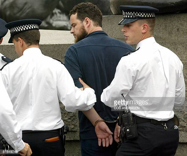 Muslim activist Sulayman Keeler is arrested for inciting the crowd at the 'Rally for Islam' at Trafalgar Square in central London 25 August 2002...