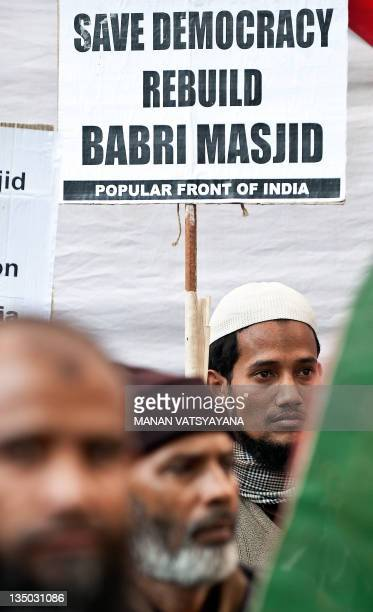 Muslim activists mark the 19th anniversary of the demolition of the 16th century Babri Mosque in Ayodhya during a protest in New Delhi on December 6...