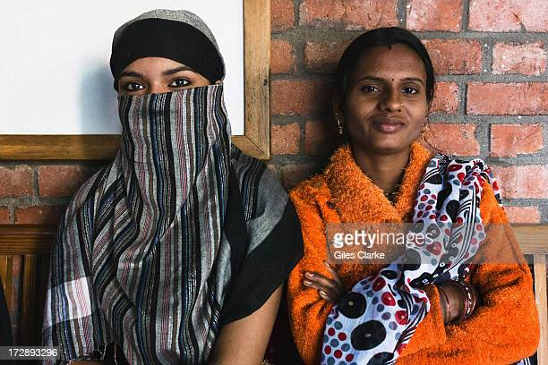 Muslim and a Hindu woman pose for a portrait at the Sambhavna Clinic where 47000 adult patients receive free treatment November 30 2012 in Bhopal...