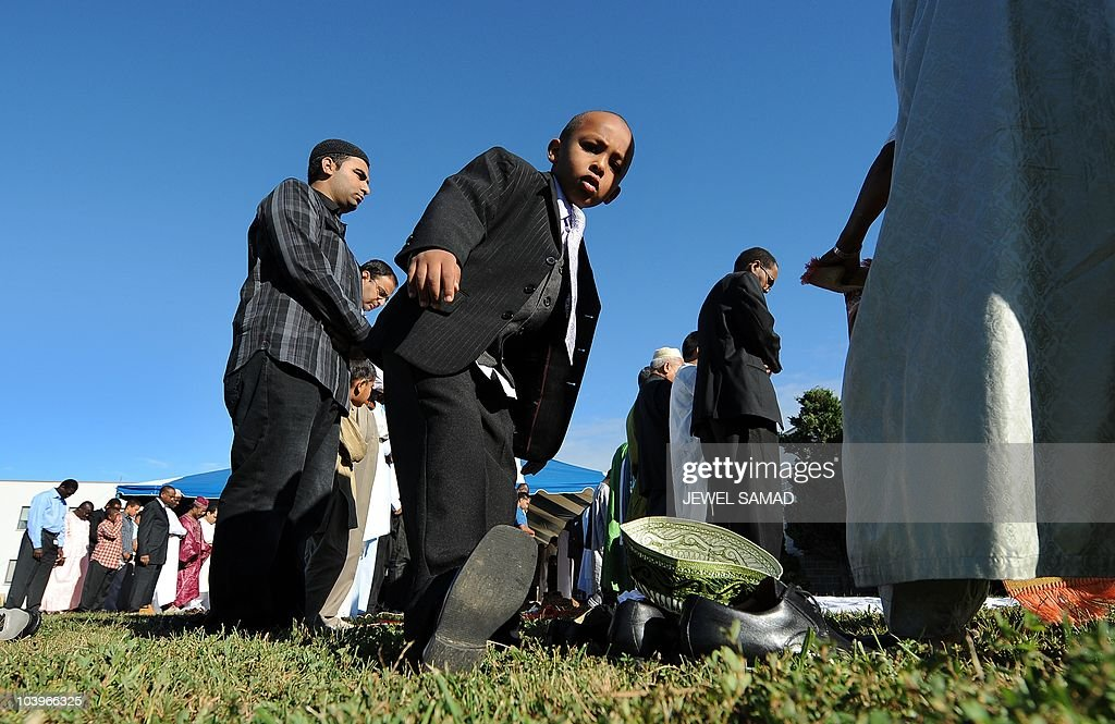 A Muslim boy takes off his shoes to take part in a special Eid-al-Fitr prayer with others at a mosque in Silver Spring, Maryland, on September 10, 2010. Thousands of rock-pelting Afghans assaulted a NATO military outpost on September 10 as fury built across the Muslim world against a US pastor's threats to immolate the Koran on the anniversary of 9/11. In a turbulent start to the festival of Eid al-Fitr, when Muslims worldwide mark the end of the Ramadan fasting month, leaders of countries including Afghanistan and Indonesia issued dire warnings against the provocative act. AFP PHOTO/Jewel Samad