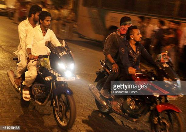 Muslim boys drive in full speed as Mumbai Police keeps vigil on streets of Parel in early morning hours after tension grips parts of the area...