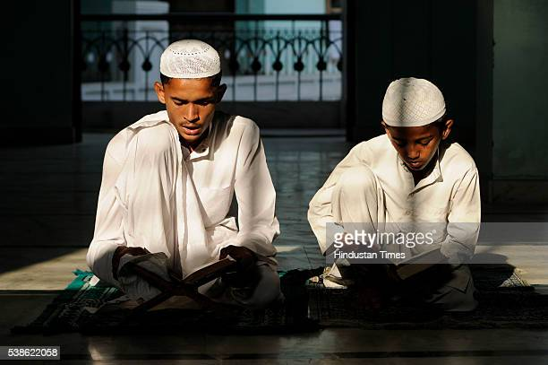 Muslim boys reciting verses from Holy Book during a Quran class on the first day of Ramadan at a Mosque on June 7 2016 in Noida India Muslims...
