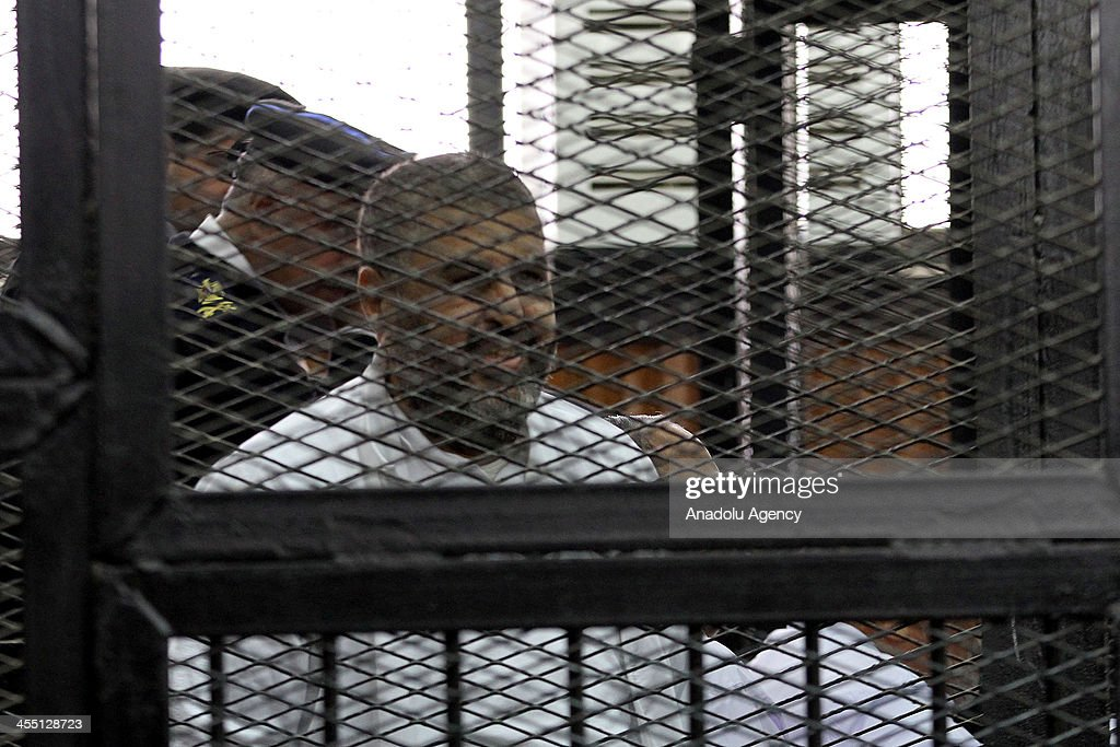 Muslim Brotherhood deputy leader Khairat al-Shater stands behind bars during the trial of Brotherhood members at a courtroom on December 11, 2013 in Cairo, Egypt. For the second time, judges presiding over the trial of Muslim Brotherhood leader Mohamed Badie and 18 other defendants withdrew from trial proceedings on Wednesday. The defendants are accused of inciting the murder of anti-Brotherhood protesters during June 30 clashes between supporters and opponents of ousted president Morsi outside the Brotherhood's Cairo headquarters.