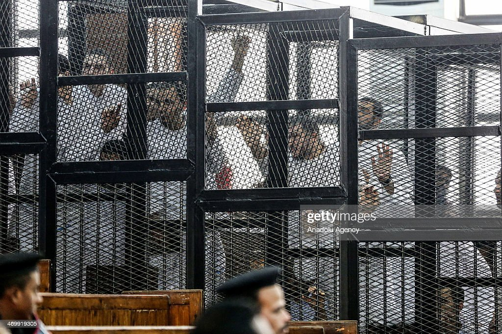 Muslim Brotherhood Leader Mohamed Badie and 47 other defendants stand behind bars during the trial of Brotherhood members at a courtroom on February 17, 2014 in Cairo, Egypt. A Cairo court on Monday adjourned to February 20 the trial of Muslim Brotherhood Supreme Guide Mohamed Badie and 47 other defendants charged with inciting violence in Egypt's Qalioubiya province last summer, judicial sources said.