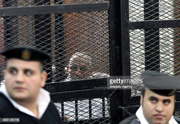 Muslim Brotherhood Leader Mohamed Badie stands behind bars during the trial of Brotherhood members at a courtroom on December 11 2013 in Cairo Egypt...