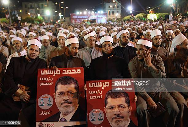 Muslim Brotherhood members sit during a final campaign rally for their presidential candidate Mohamed Morsy on May 20 2012 in Cairo Egypt Sunday was...