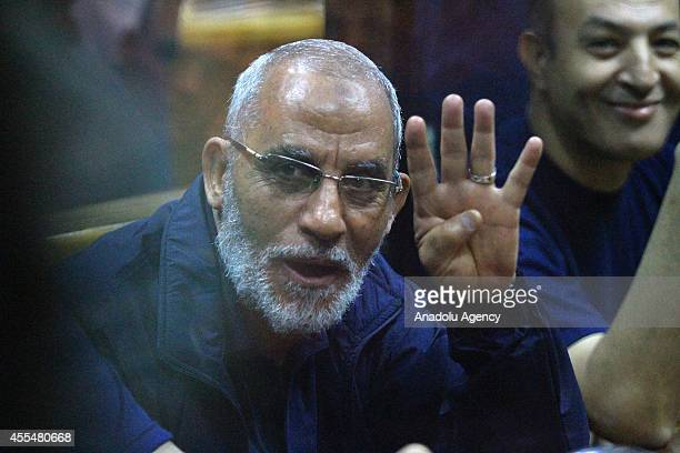 Muslim Brotherhood Supreme Guide Mohamed Badie flashes rabia sign during the trial of Mohamed Morsi and 130 other defendants over the Wadi elNatrun...