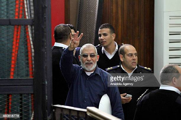 Muslim Brotherhood's Supreme Guide Mohamed Badie charged with breaking out of jail in 2011 flashes Rabia sign during his trial in Police Academy in...