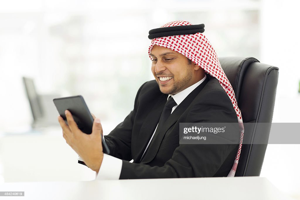 muslim businessman using tablet computer : Stock Photo