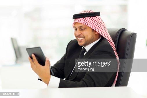 muslim businessman using tablet computer : Stock Photo