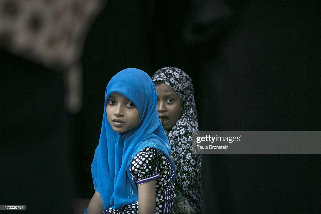 Muslim children attend a special evening Ramadan prayer at the Juma Masjid July 10, 2013 in Colombo, Sri Lanka. The ninth month of the Islamic calendar is observed as a month of fasting by Muslims across the globe. In Sri Lanka there are three distinct groups making up the Muslim community; the Sri Lankan Moors, the Indian Muslims and the Malays. Women in Sri Lanka are under pressure by the Budhist activist group, the Bodu Bala Sena to not wear the wear the traditional niqab.