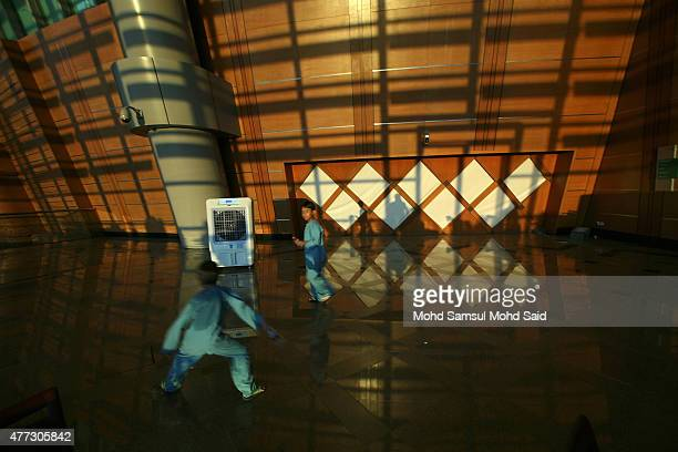 Muslim children play inside the hall as Malaysia's Islamic authority perform 'rukyah' the sighting of the new moon of Ramadan on June 16 2015 in...
