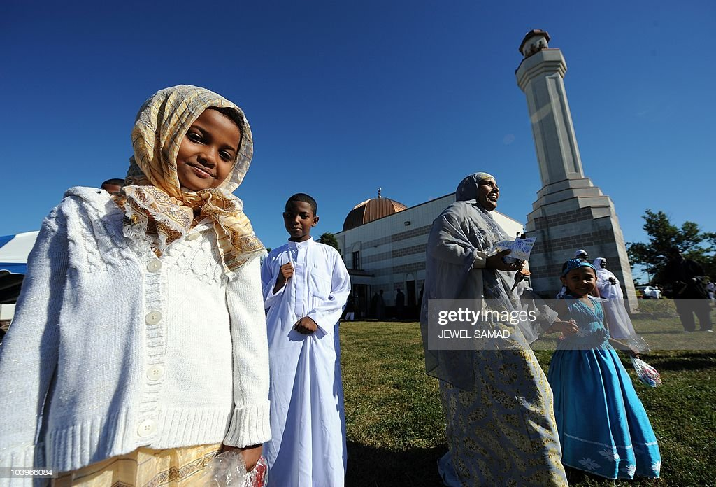 Muslim children wearing new cloths leave after taking part in a special Eid-al-Fitr prayer at a mosque in Silver Spring, Maryland, on September 10, 2010. Thousands of rock-pelting Afghans assaulted a NATO military outpost on September 10 as fury built across the Muslim world against a US pastor's threats to immolate the Koran on the anniversary of 9/11. In a turbulent start to the festival of Eid al-Fitr, when Muslims worldwide mark the end of the Ramadan fasting month, leaders of countries including Afghanistan and Indonesia issued dire warnings against the provocative act. AFP PHOTO/Jewel Samad