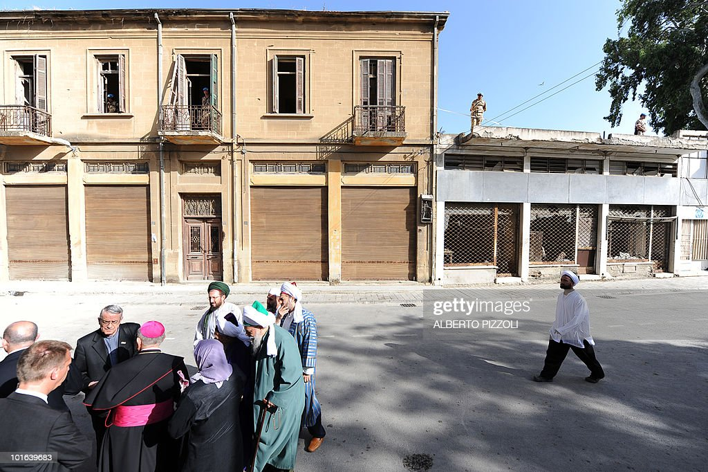 Muslim clergymen arrive at Nicosia's Latin Holy Cross Church on the Green Line in the divided capital of Cyprus to meet Pope Benedict XVI on June 5, 2010, on the second day of the pontiff's visit to the mainly Greek Orthodox east Mediterranean island.