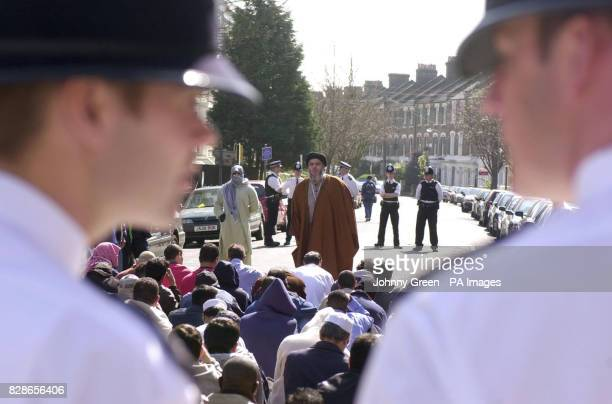 Muslim cleric Abu Hamza addresses an audience of around 120 during lunchtime prayers outside Finsbury Park Mosque in north London Friday 4 April 2003...