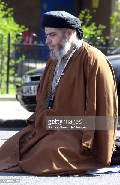 Muslim cleric Abu Hamza before addressing an audience of around 120 during lunchtime prayers outside Finsbury Park Mosque in north London * Mr Hamza...