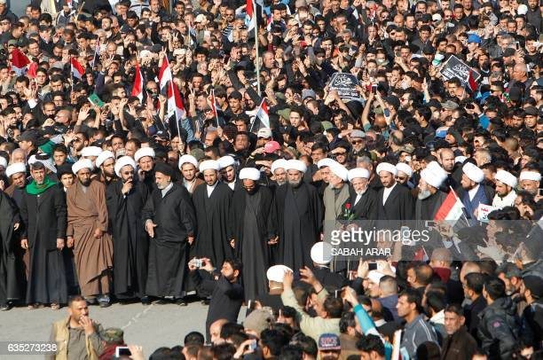 Muslim clerics and protesters mostly supporters of Iraq's prominent cleric Moqtada Sadr take part in a mock funeral procession in Baghdad on February...