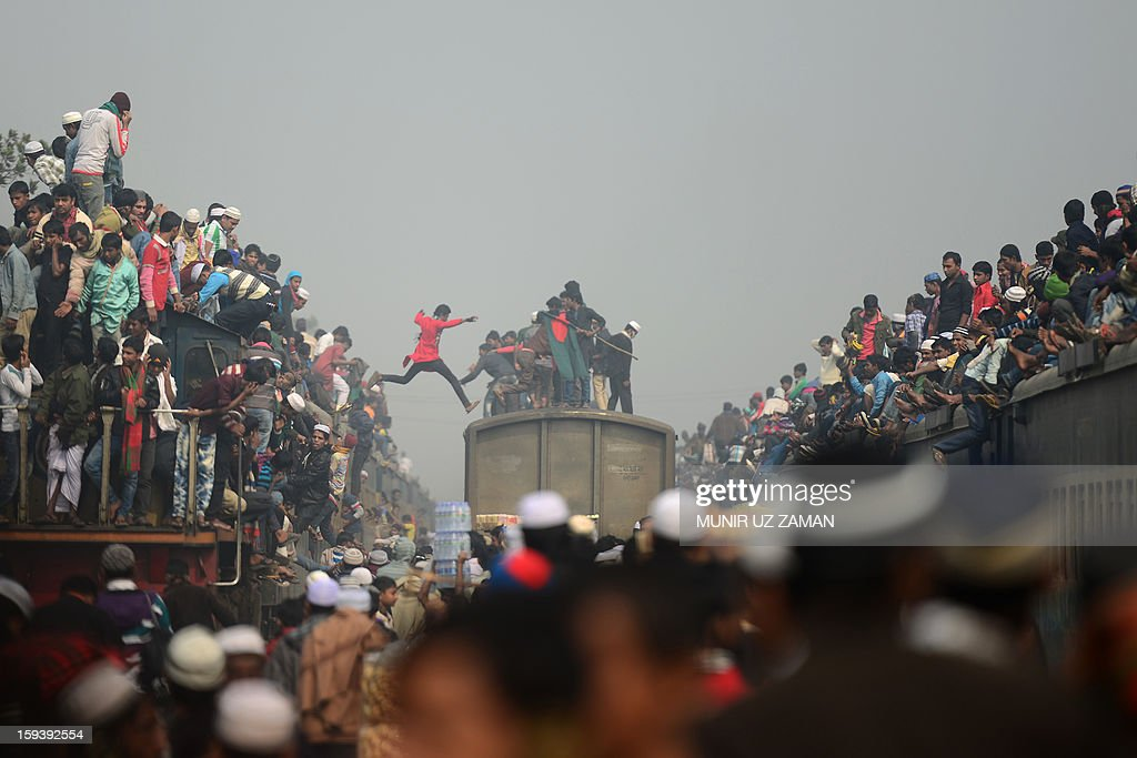 Muslim devotees arrive on overcrowded trains to attend the Biswa Ijtema or World Muslim Congregation at Tongi, about 30 kms north of Dhaka on January 13, 2013. At least three million Muslims joined a prayer on the banks of a river in Bangladesh as the world's second largest annual Islamic congregation ended today. AFP PHOTO/ Munir uz ZAMAN