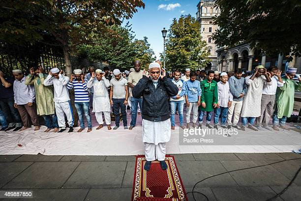 Muslim devotees attend a morning prayer marking the 'Eid alAdha' or Feast of Sacrifice on a street in Rome 'Eid alAdha' is a religious festival...