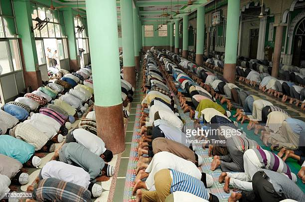 Muslim devotees perform congregational prayers at a Mosque on the first day of the fasting month of Ramadan on July 11 2012 in Noida India Muslims...