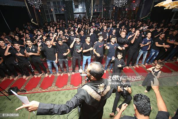Muslim devotees take part in a morning procession marking the day of Ashura Imam Baqir Mosque in Baghdad Iraq on October 09 2016 Shiite Muslims are...