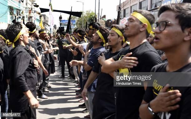Muslim devotees take part in a mourning procession marking the day of Ashura 10 MuharramulHaram at Shia Jama Masjid Kashmiri Gate on October 1 2017...