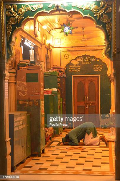 Muslim doing namaj late at night on the Islamic month of Ramadan Ramadan is the 9th month in the Islamic calendar It is a point of prayer fasting...