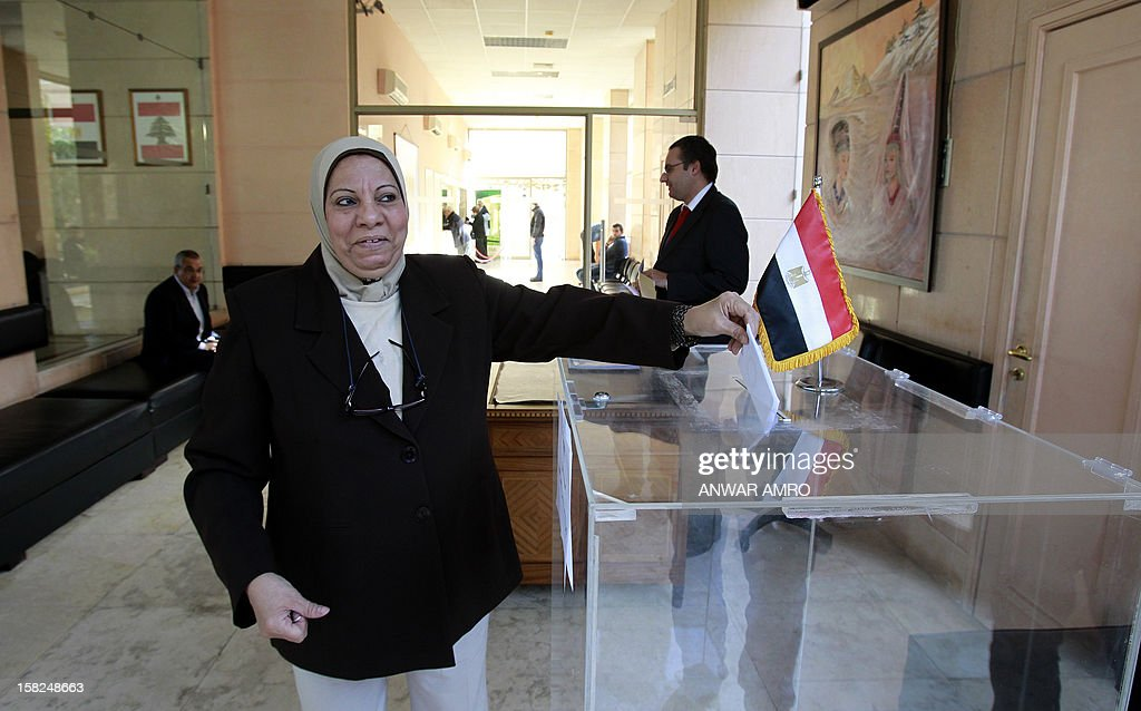 A Muslim Egyptian woman residing in Lebanon votes on a divisive draft constitution at the Egyptian embassy in Beirut on December 12, 2012. The expatriate vote -- itself postponed for days -- began with the polling of more than 500,000 Egyptians at embassies and consulates in 150 countries, Egypt's official news agency MENA said as the country's charter pitted Islamist allies of President Mohammed Morsi against secular-leaning foes in rival rallies that clashed last week.