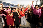 Muslim ethnic Uighurs protest in Urumqi in China's far west Xinjiang province on July 7 2009 Police fired tear gas to disperse thousands of Han...